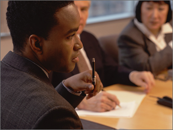 African American businessman at a table